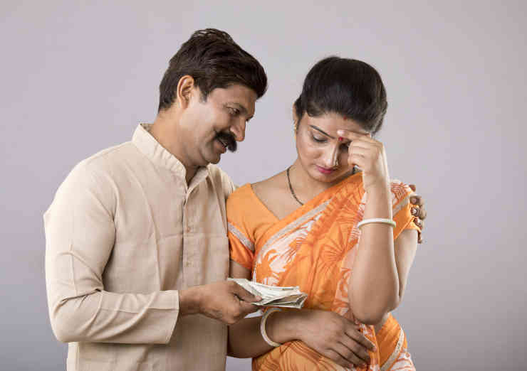 Man giving money to wife