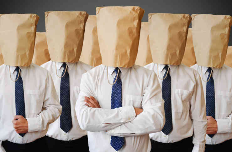 army of businessman with a paper bag on head