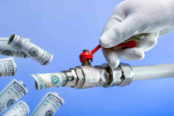 Spend Budget Money. Hand Opens The Tap With Money. Money Flows.